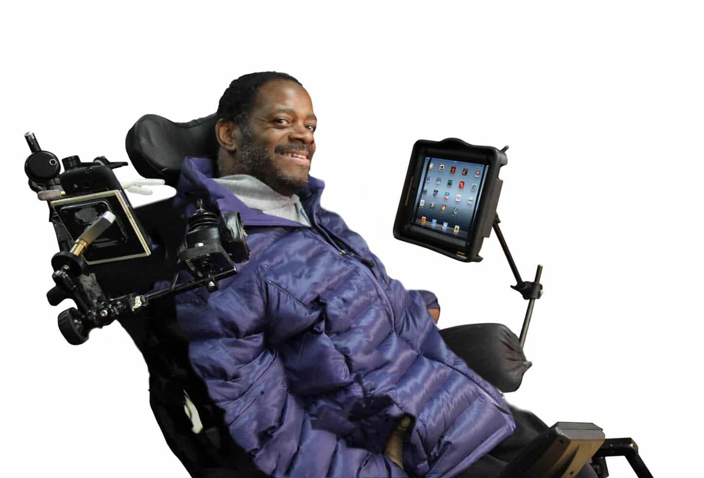 Photo of man in wheelchair with iPad assistive devices