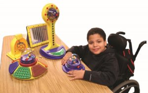 Photo of boy playing with adapted toys