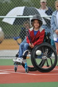 Photo of child in wheelchair at bat