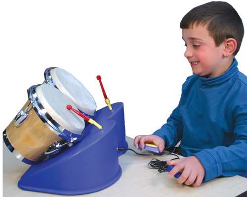 Photo of boy playing with adaptive drum set