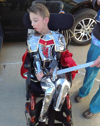 Photo of child in wheelchair dressed as a knight