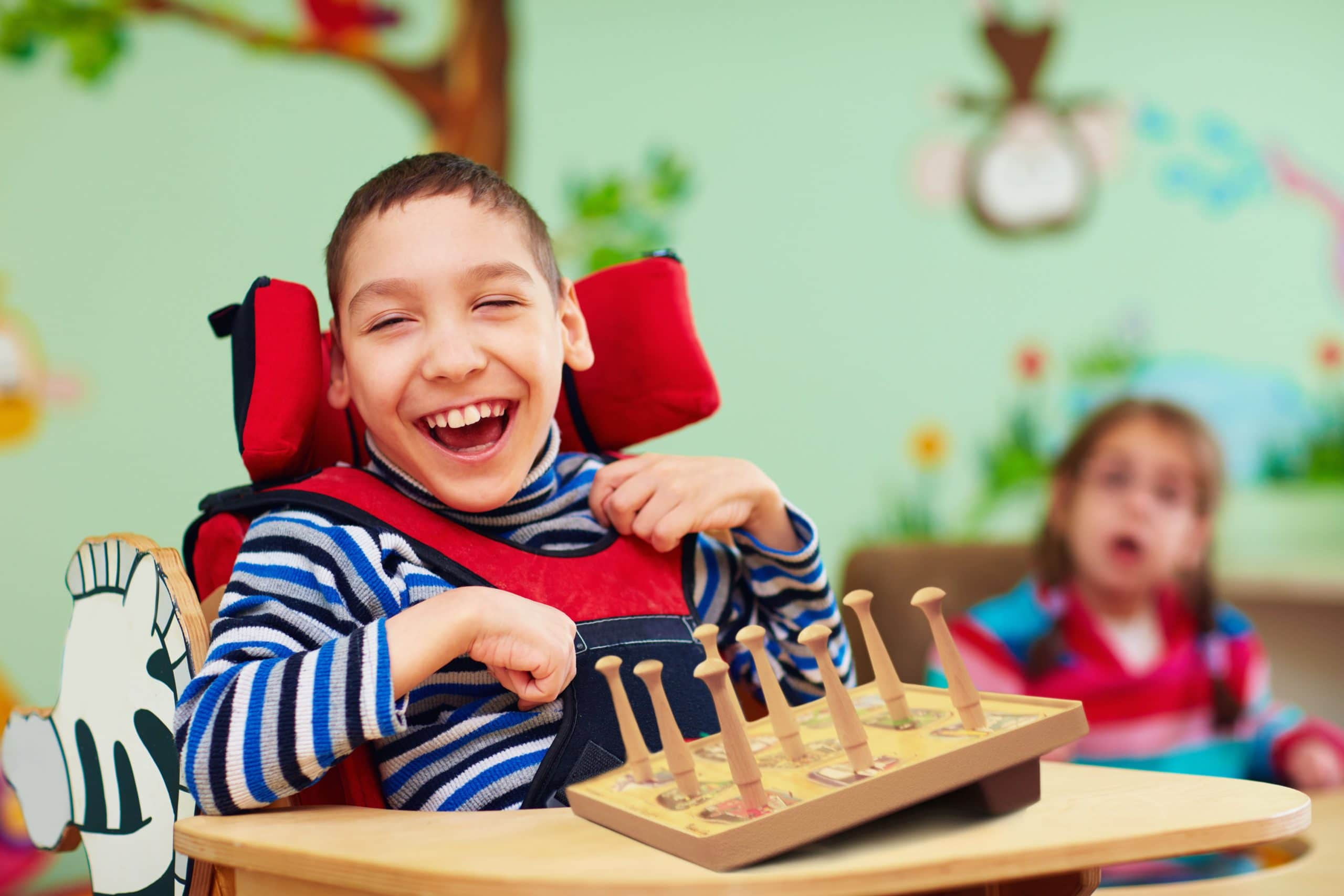 Young Boy with Cerebral Palsy Playing with a Puzzle