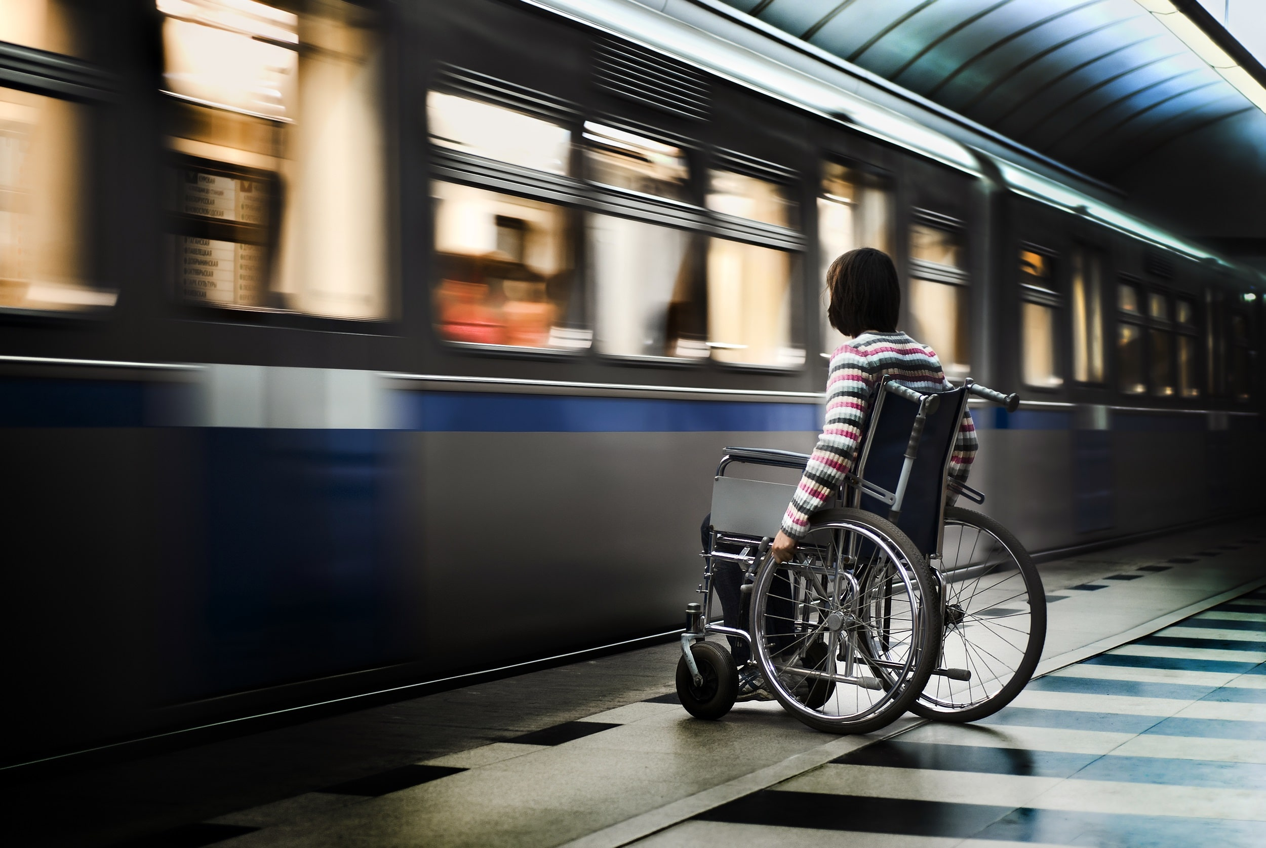 Woman in Wheelchair Waiting for Subway