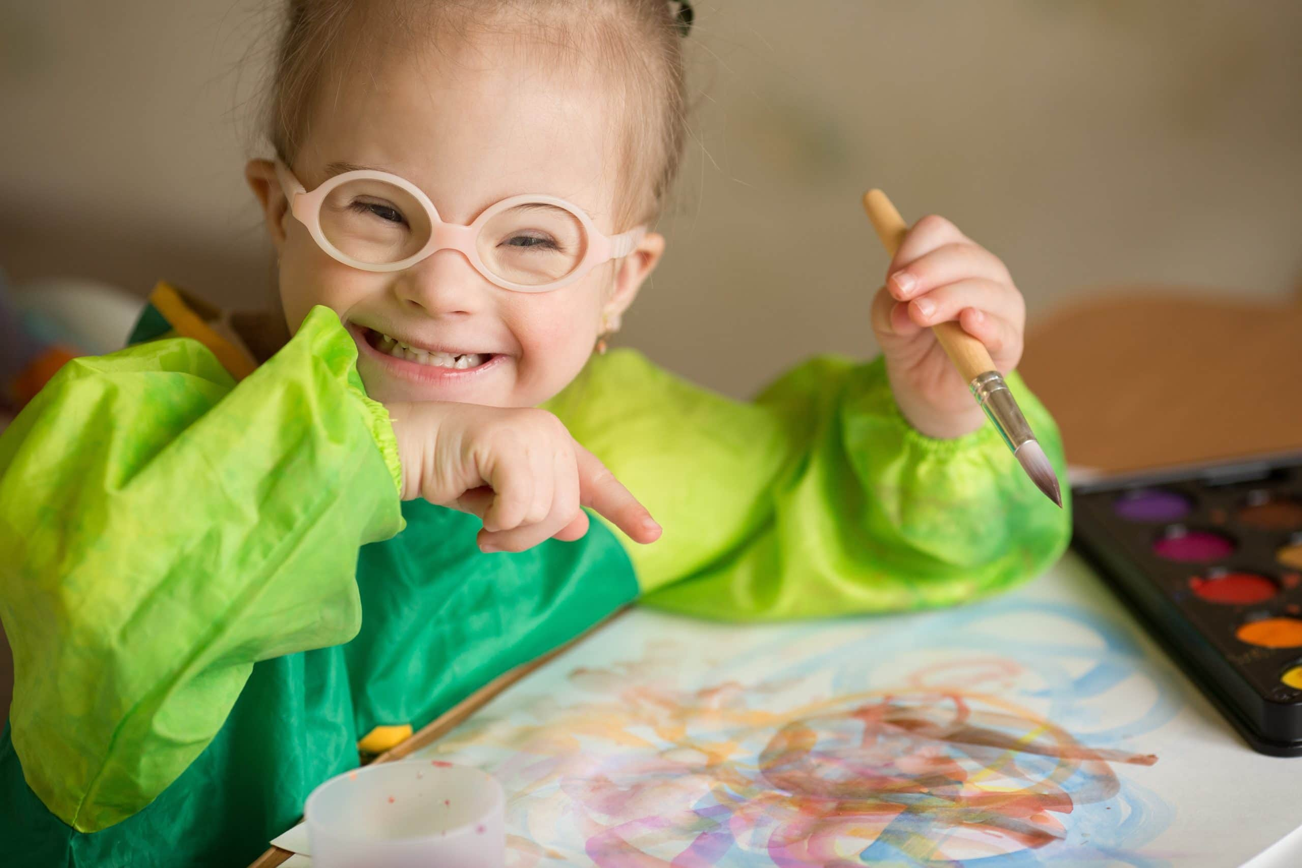 Little Girl Painting with Watercolor