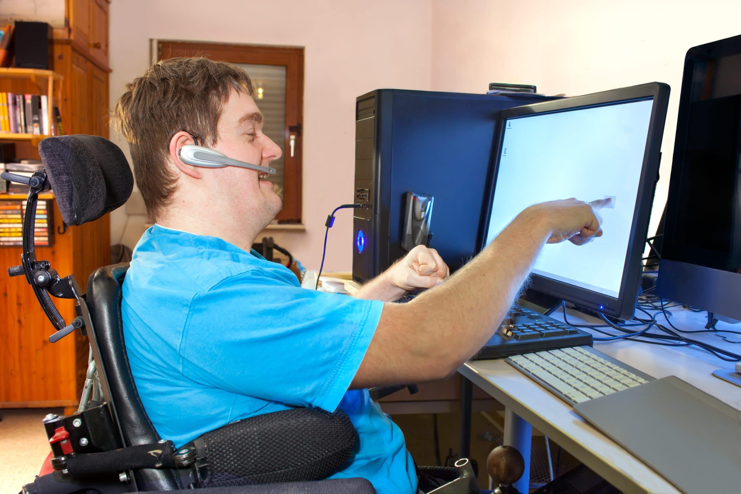 Man In Wheelchair Working on a Computer