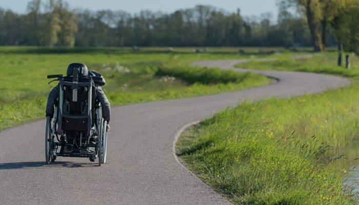 Man in Wheelchair on a Winding Road