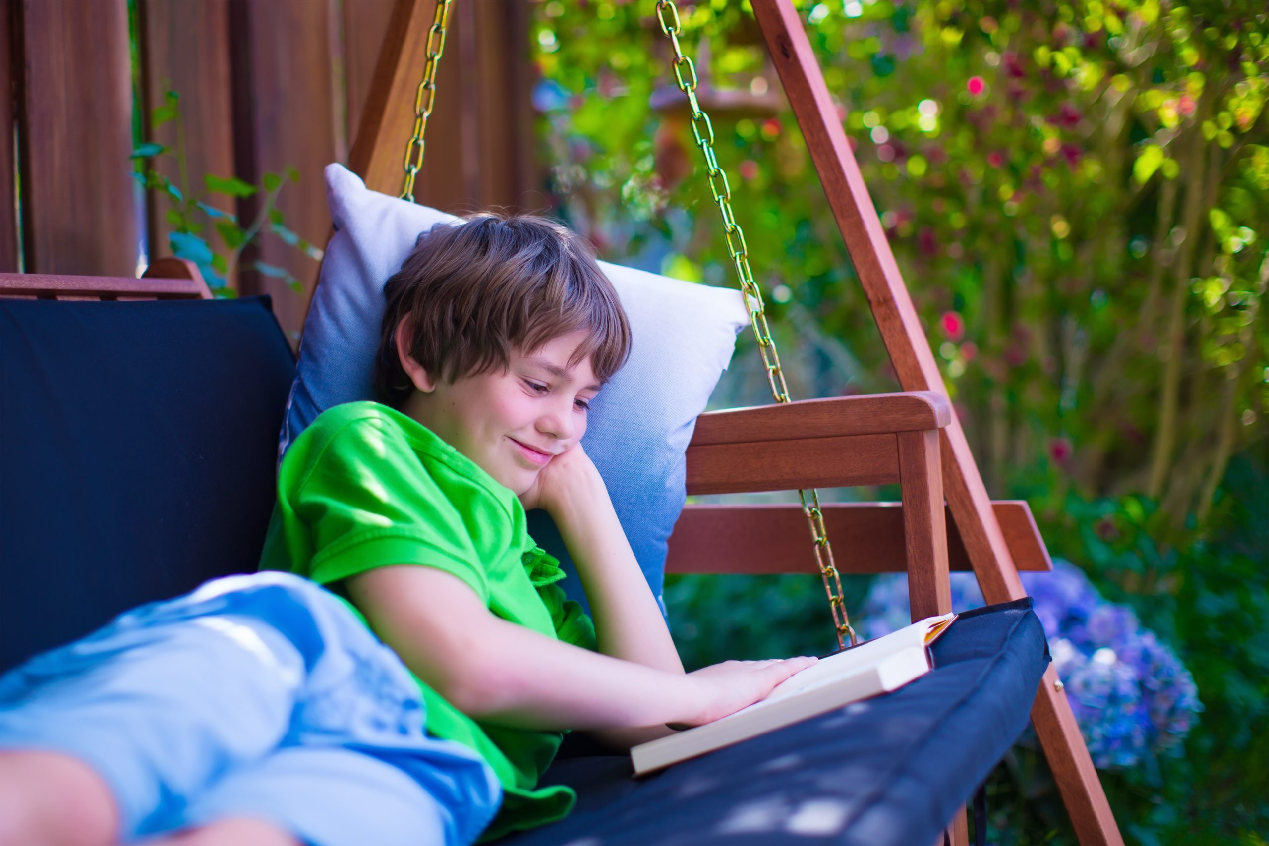 Boy on Porch Swing Reading a Book