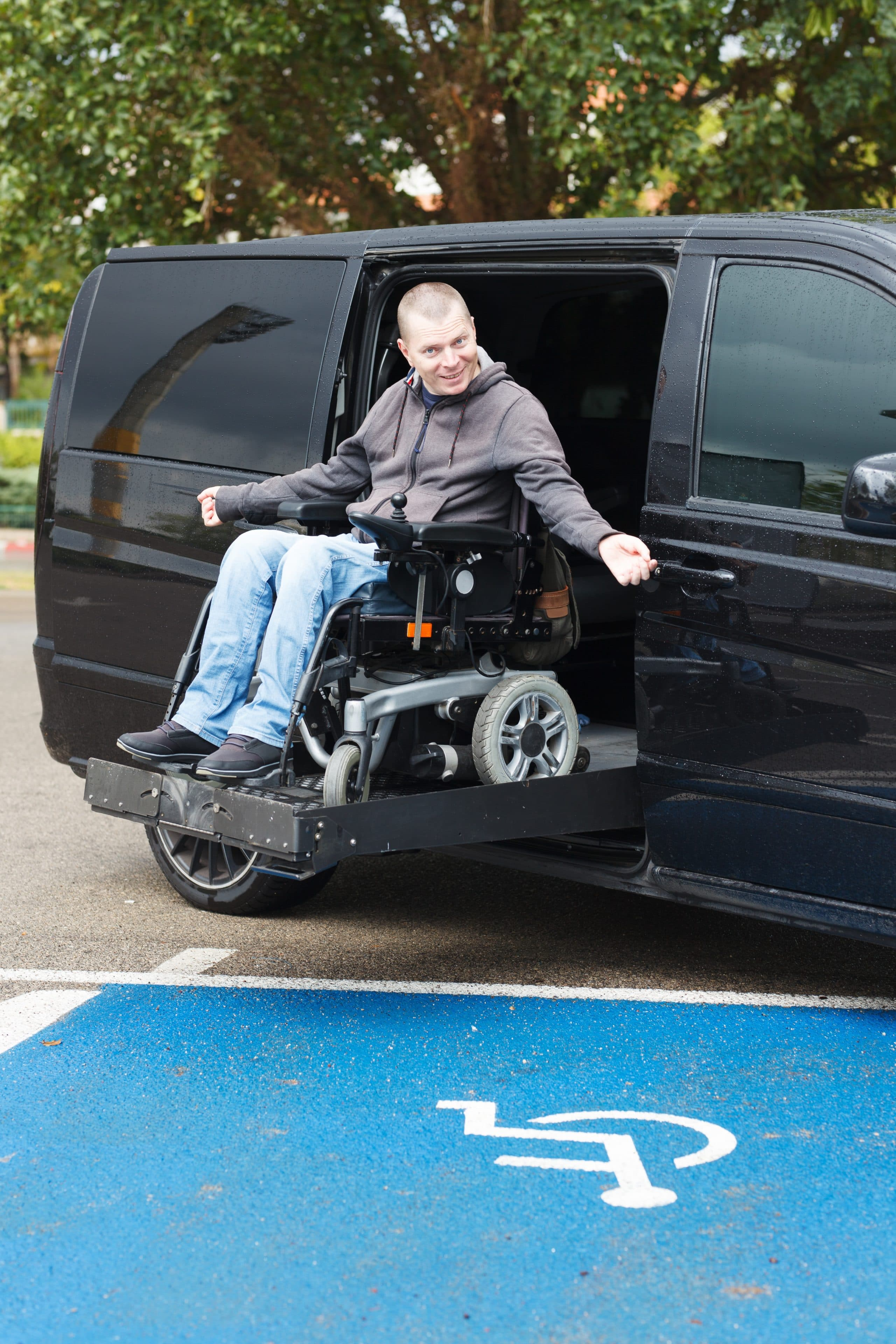 Man in Wheelchair getting out of an Accessible Van