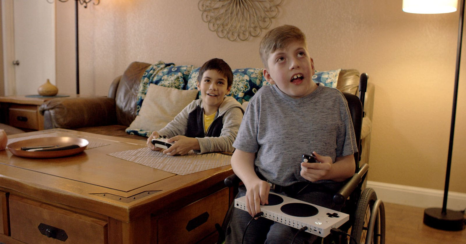 Disabled Boy playing with microsoft adapted controller