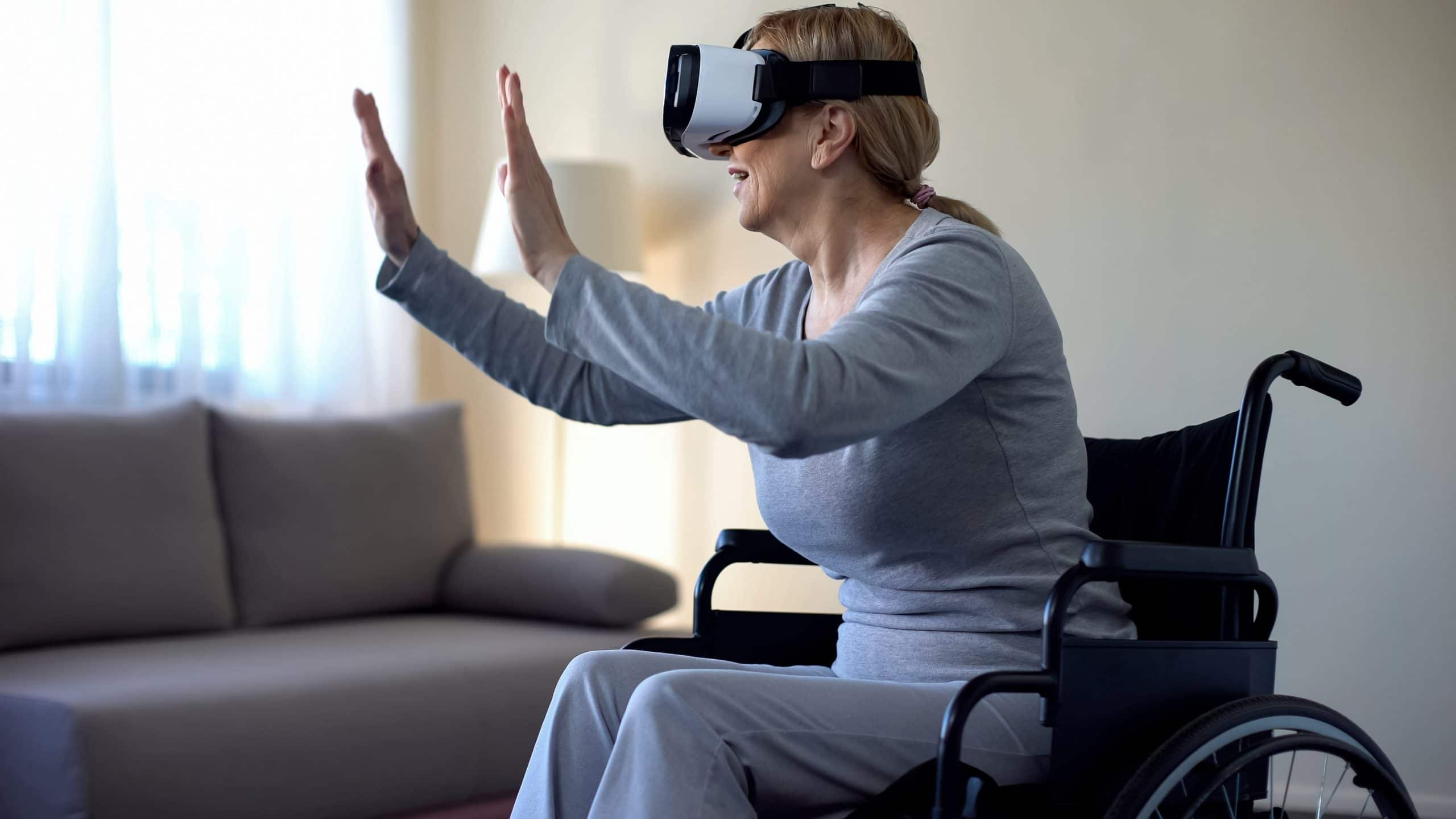 Woman in Wheelchair using a Virtual Reality Headset