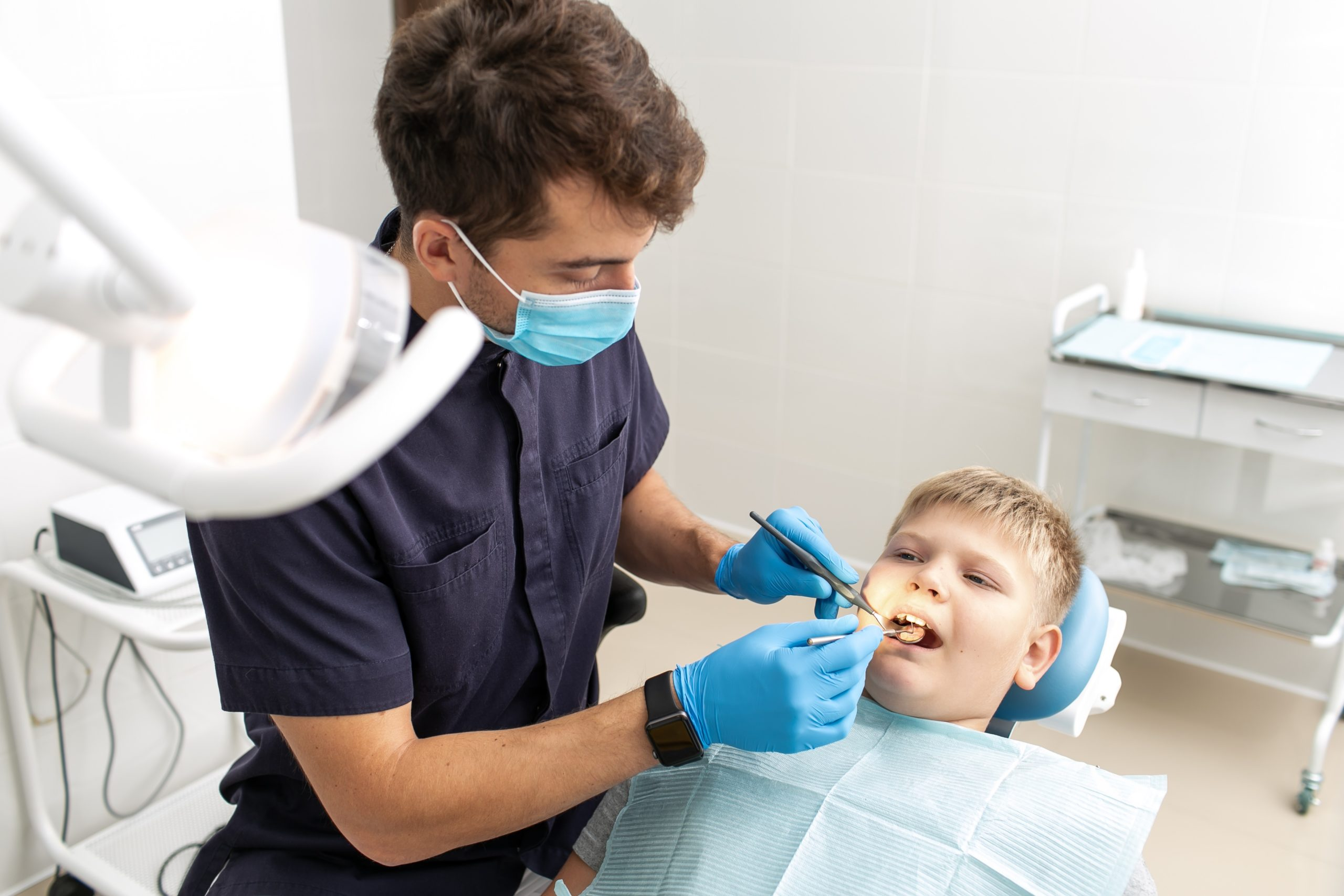 Dentist Treating Young Boy