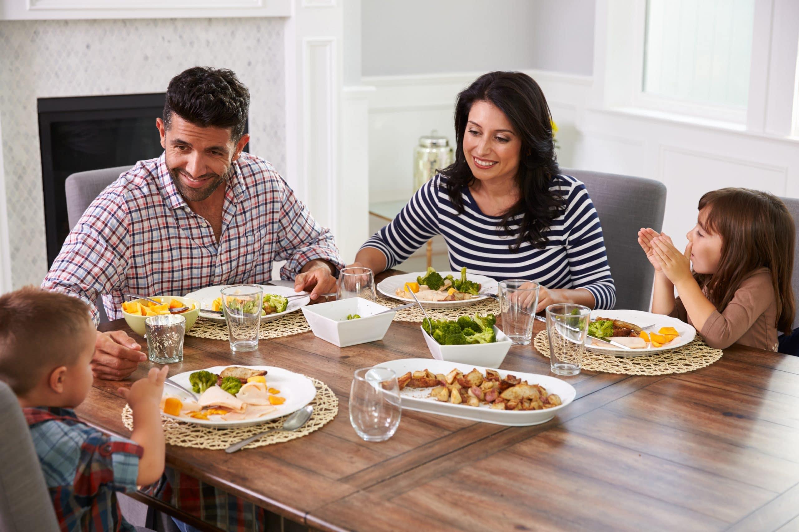 Family of Four Enjoying Dinner Together